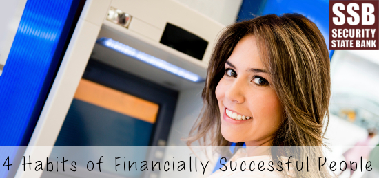 Happy woman ready to take money out of an ATM